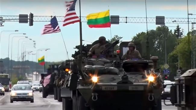 American armed vehicles march through Lithuanian streets ahead of NATO military drills