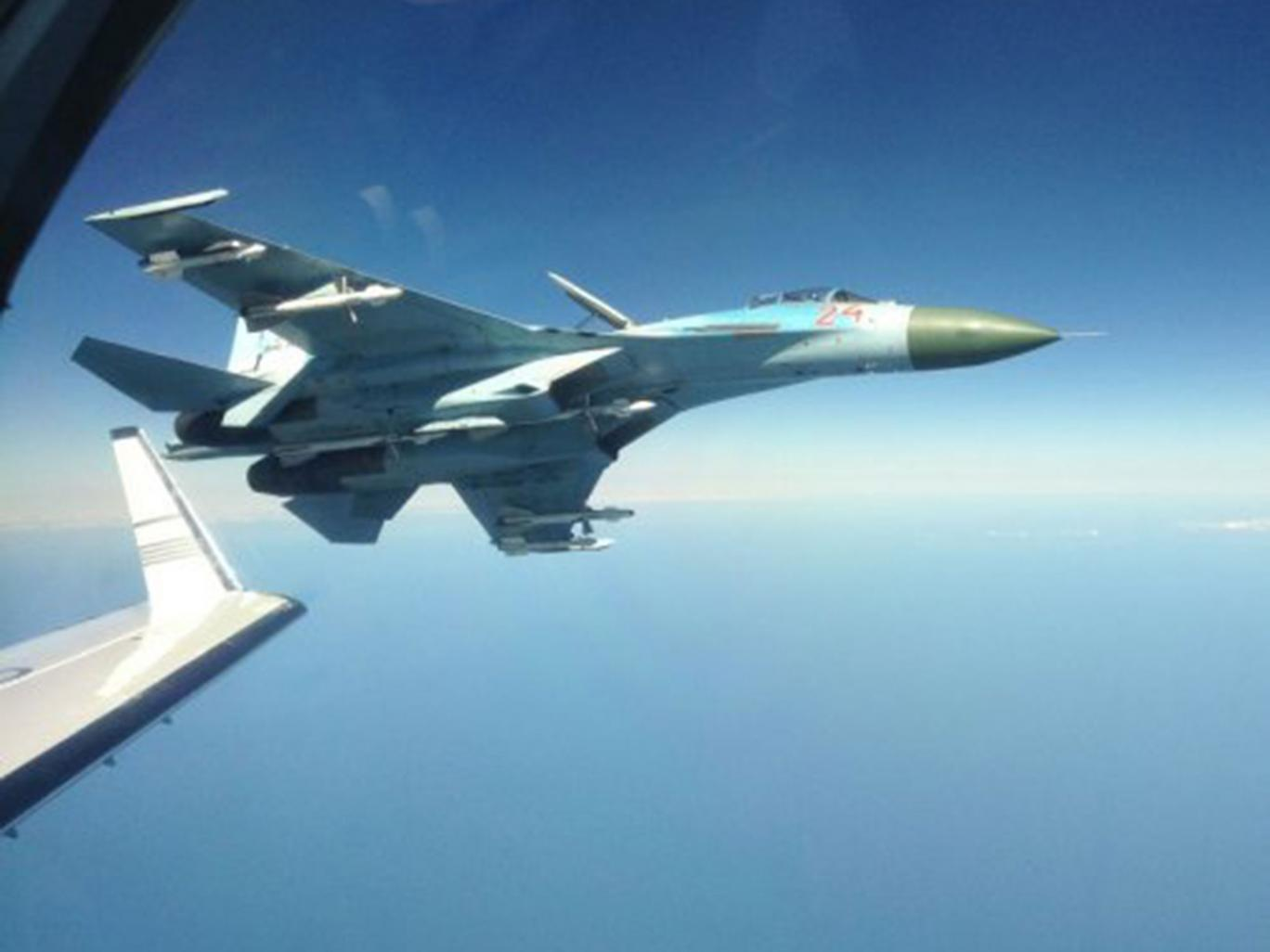 A Russian su-27 fighter jet photographed next to a Swedish intelligence plane in 2014 FRA