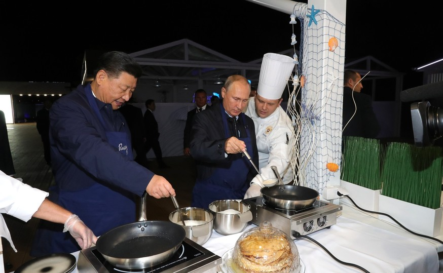 Putin_drank_vodka,_ate_pancakes_and_embarrassed_workers