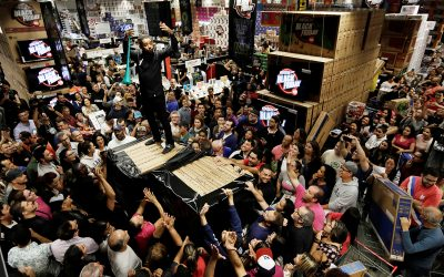 Shoppers reach for retail items on Black Friday at a store in Sao Paulo
