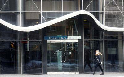A woman walks past Danske Bank's Estonian branch in Tallinn
