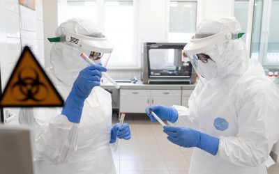 Laboratory workers wearing protective suits are seen at the laboratory which performs diagnostic tests for coronavirus in Olsztyn
